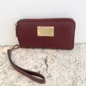 Authentic burgundy Michael Kors clutch